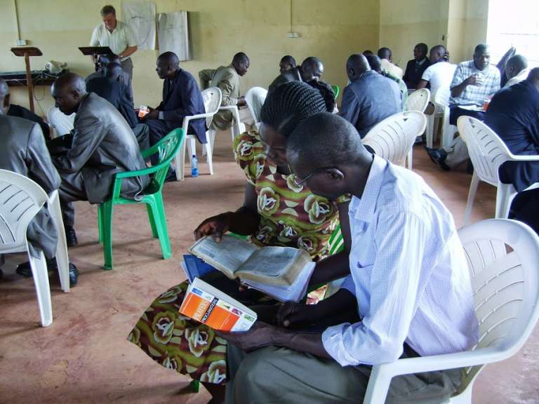 Donated books being used in an African church